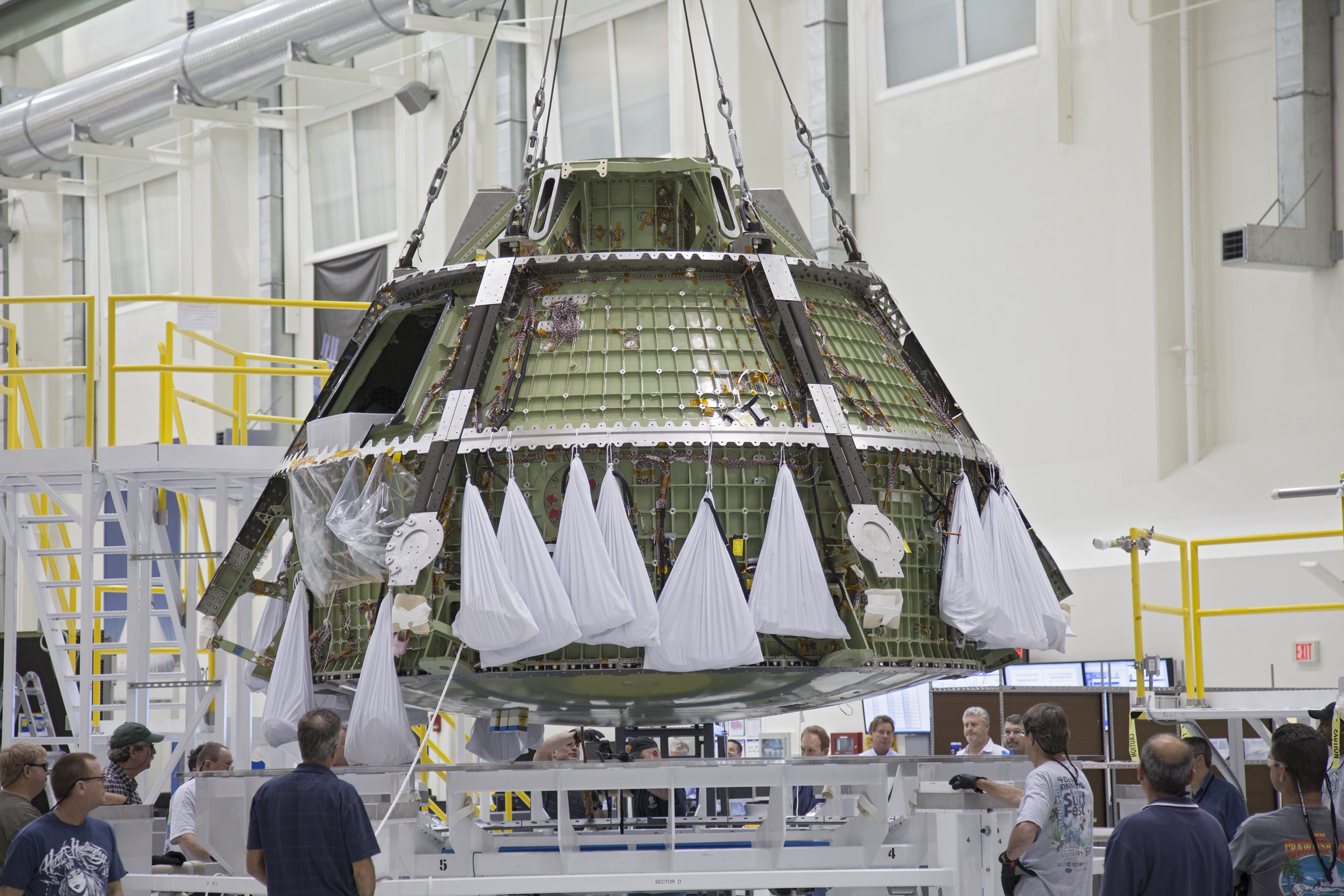 The walkway that astronauts will cross when boarding NASAs next spacecraft bound for the moon has now been raised into place A crane hoisted the Orion